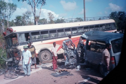 crash between a Ford Aerostar and a bus