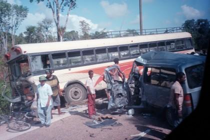 crash between a Ford Aerostar and a bus
